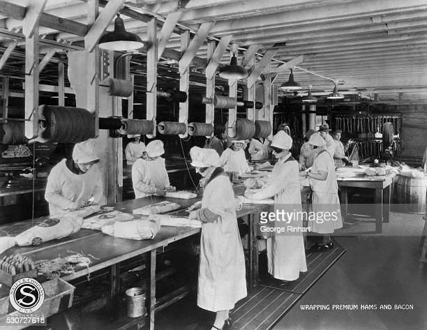 THE MEAT PACKING INDUSTRY Photo shows workers wrapping Swift's Premium Hams and Bacon Three thicknesses of paper protect the hams which pass final...