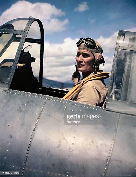 Photo shows World War II aviator Joe Foss seated in the cockpit of a plane