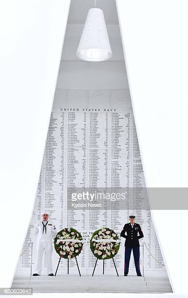 Photo shows wreaths laid by Japanese Prime Minister Shinzo Abe and US President Barack Obama at the USS Arizona Memorial at Pearl Harbor in Hawaii on...