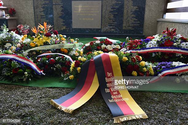 A photo shows wreaths of flowers at the Vernet memorial southwestern France on March 24 2016 during commemoration ceremonies to mark the first...