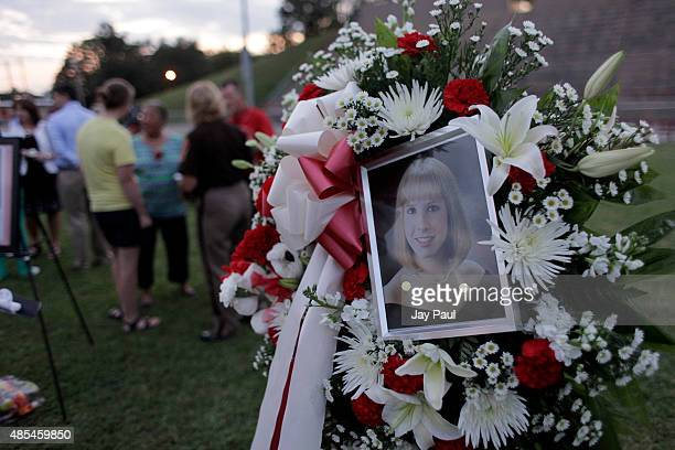 Photo sits amonst flowers at a candlelight vigil for Alison Parker on Martinsville High School's football field on August 27, 2015 in Martinsville,...