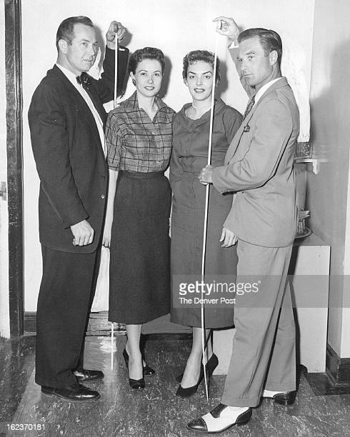 MAR 11 1956 Photo Special to The Denver Post Officers of the TipToppers Arizona club for tall men and women pose together Shown are Jim Harris 6'5...