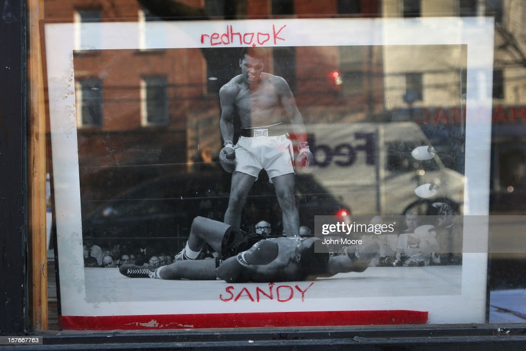 A photo stands in the window of an art gallery in the Red Hook neighborhood of Brooklyn on December 5, 2012 in New York City. More than a month after superstorm Sandy flooded the area, many businesses have been slow to reopen and damaged homes remain vacant.