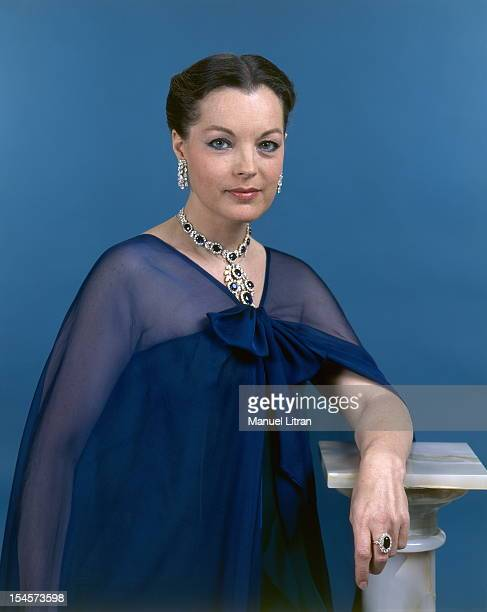 Photo studio Romy Schneider on the occasion of his 40th birthday: plan smiling face of the actress in blue dress and Yves Saint Laurent dress with a...