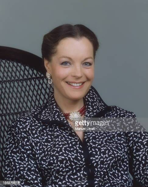 Photo studio Romy Schneider on the occasion of his 40th birthday plan smiling face of the actress in dress and Yves Saint Laurent dress with a Van...