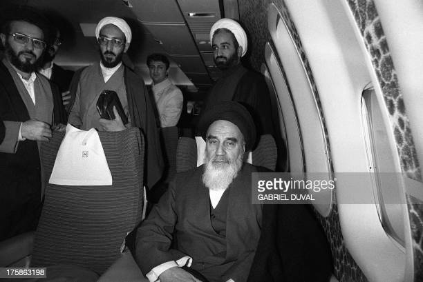 Photo taken 01 February 1979 at Tehran airport of revolutionary leader Ayatollah Ruhollah Khomeini posing aboard the Air France Boeing 747 jumbo that...