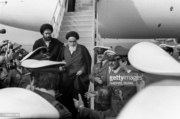Photo taken 01 February 1979 at Tehran airport of revolutionary leader Ayatollah Ruhollah Khomeini leaving the Air France Boeing 747 jumbo that flew...