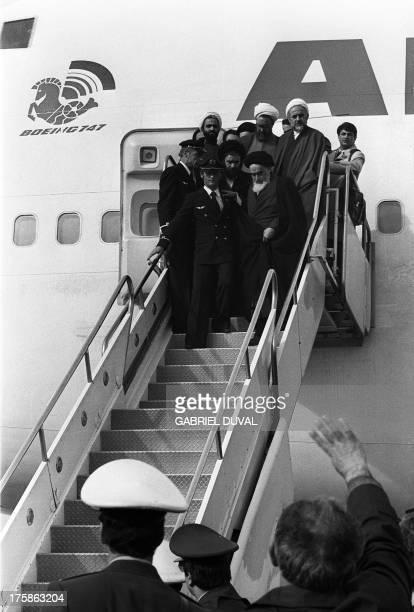 Photo taken 01 February 1979 at Tehran airport of revolutionary leader Ayatollah Ruhollah Khomeini leaving the Air France Boeing 747 jumbo that flew...