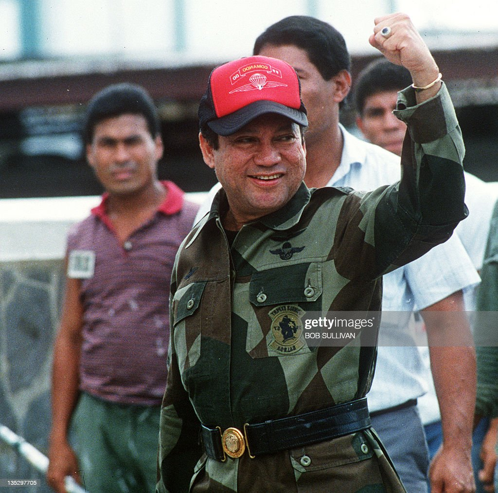A photo taken 04 October 1989 shows former Panamanian strongman General Manuel Noriega waving as he left his headquarters in Panama City following a failed coup against him. Noriega goes on trial 10 June 1999 in Paris on money-laundering charges linked to the purchase of several sumptuous apartments in the French capital with alleged drug money.
