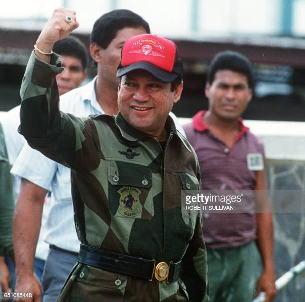 Photo taken 04 October 1989 shows former Panamanian strongman General Manuel Noriega waving as he left his headquarters in Panama City following a...