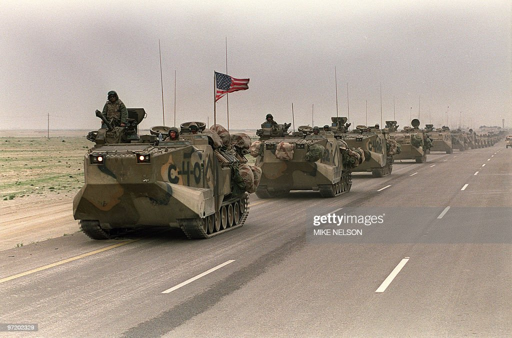 Photo taken 05 March 1991 of a convoy of US Army tanks driving down the road from Kuwait towards Dhahran in the Saudi desert as US troops begin their withdrawal from Kuwait.