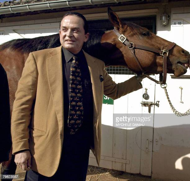 A photo taken 07 March 2002 in Deauville western France shows art dealer and horse owner Alec Wildenstein posing with his horse Kesaco Phedo winner...