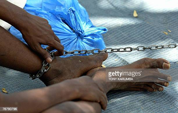 A photo taken 08 September 2007 shows a psychologicallydisturbed Somali man chained to a tree at the psychiatric ward of the general hospital of the...