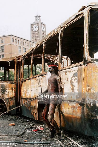 Photo taken 10 June 1989 in Beijing of the naked and bunt body of a soldier hung on a city bus by angry crowd stayed at the same sport for four days...