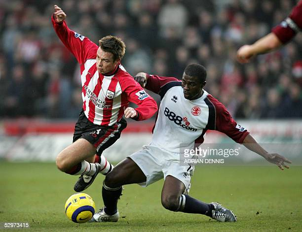 Photo taken 11 December 2004 of Southampton's Graeme Le Saux being tackled by George Boateng of Middlesbrough during the Premiership match at St...