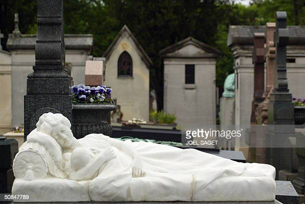 A photo taken 12 May 2004 of a tombstone with a statue at Pere Lachaise Cemetery in Paris Pere Lachaise is the largest cemetery in Paris and one of...