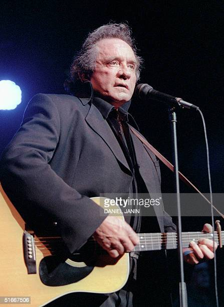 Photo taken 16 April 1997 in Bourges of US country singer Johnny Cash performing during the Printemps de Bourges Festival Johnny Cash died at the age...