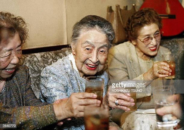 Photo taken 16 May 2003 shows Hideko Arima 101yearold bar proprietress drinking during her 101st birthday party at her tiny bar GilbeyA at Ginza...