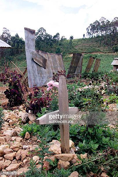 Photo taken 21 March 2000 shows an old grave next to the only standing remnants of the church of the movement for the Restoration of the Ten...