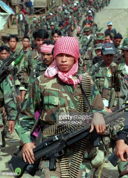 Photo taken 27 February 1999 shows armed separatist Muslim guerrillas of the Moro Islamic Liberation Front marching in formation at Camp Abubakar,...