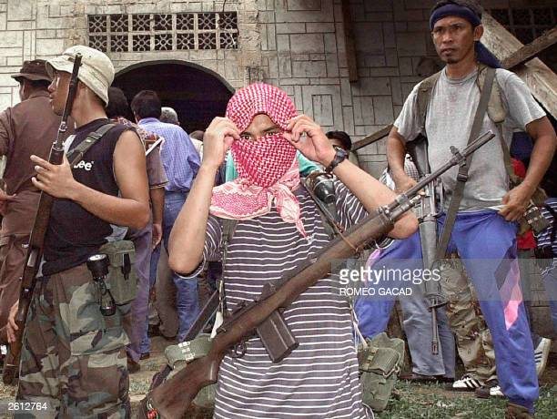 Photo taken 27 May 2000 shows Muslim Abu Sayyaf rebels holding Western hostages taking position outside the mosque in their stronghold in Jolo island...