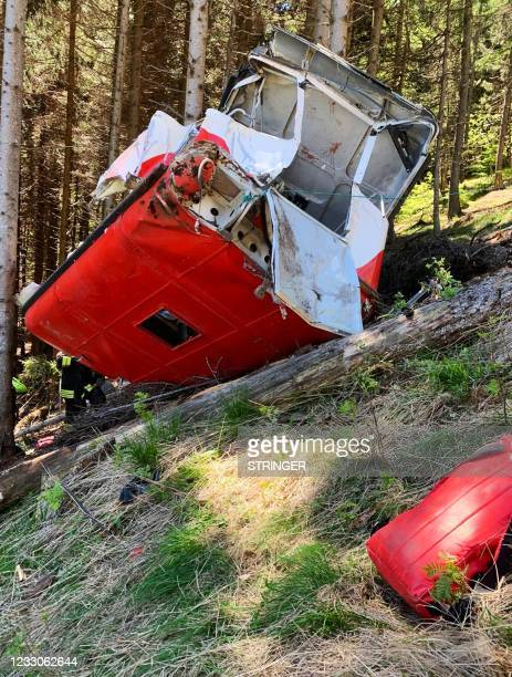 Photo taken and obtained on May 23, 2021 from Italian News agency Ansa shows a cable car that crashed to the ground in the resort town of Stresa on...