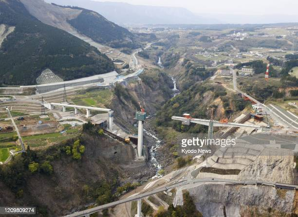 Photo taken April 11 from a Kyodo News helicopter shows Aso Ohashi bridge under reconstruction in the Kumamoto prefecture village of Minamiaso in...
