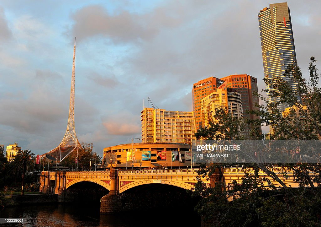 A photo taken April 2, 2010 shows the Arts Centre Spire (L) which sits over a complex of theatres and concert halls in the Melbourne Arts Precinct. The metal webbing of the spire is influenced by the billowing of a ballerina's tutu and the Eiffel Tower. AFP PHOTO/William WEST