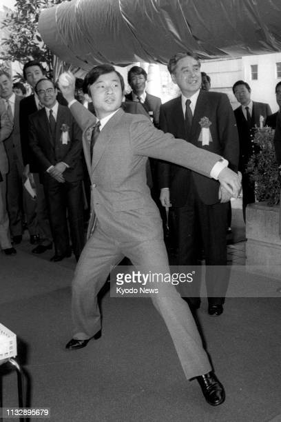 Photo taken April 4 shows Prince Hiro now Japanese Crown Prince Naruhito ready to throw a ball at unbreakable glass at an exhibition of new materials...