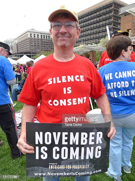Photo taken at Independence Hall, Phildelphia during a 2010 Tea Party rally. Man wearing shirt stating 'Silence is Consent' and holding sign stating...