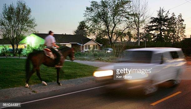 Photo taken at night where homeowners ride their horses through their neighborhoods. Story about how Sylmar is trying to retain its equestrian...