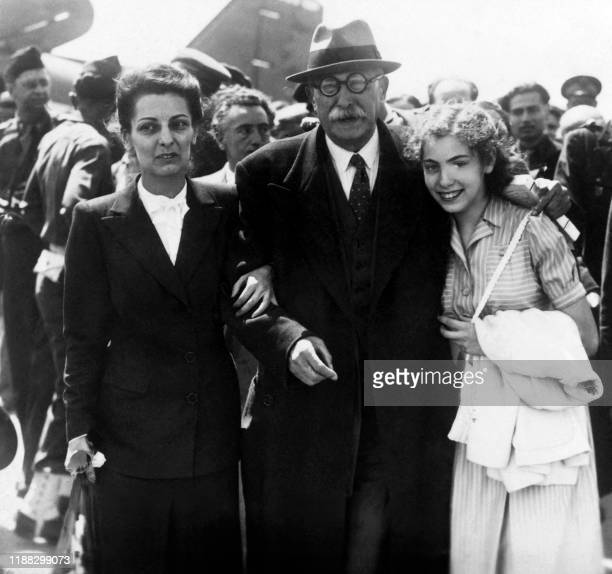 Photo taken at Orly airport on May 14 1945 shows French politician Leon Blum with his daughterinlaw Renee Blum and granddaughter Catherine Blum on...