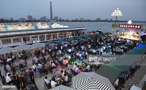 Photo taken Aug 12 shows North Korea's first beer festival which started in Pyongyang on the same day in line with its leader Kim Jong Un's promise...