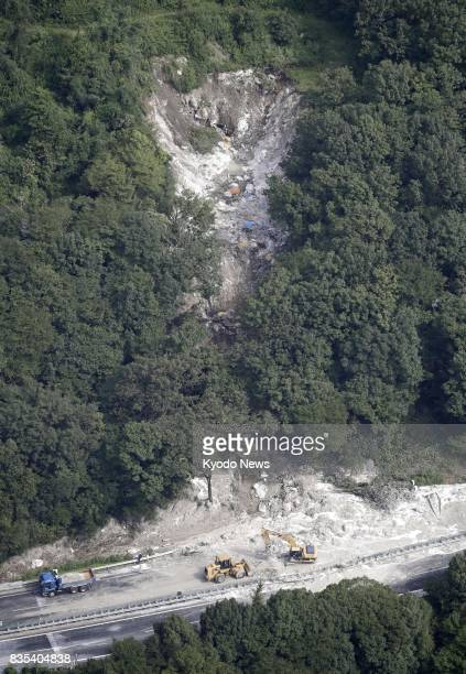Photo taken Aug 19 from a Kyodo News helicopter shows the scene of a landslide on the Chuo Expressway in Mizunami Gifu Prefecture central Japan...