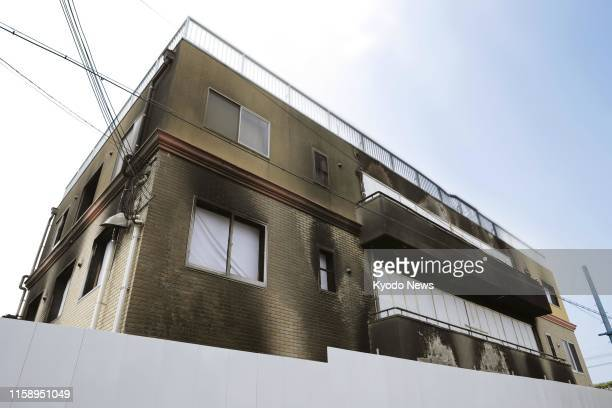 Photo taken Aug 2 shows the burntout threestory studio of Kyoto Animation Co in Kyoto western Japan The names of 10 of the 35 people killed in an...