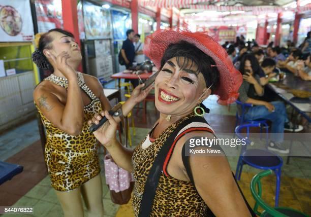 Photo taken Aug 21 shows transgender dancers Wisnu Setiawan and Nur Handoko Lesbian gay bisexual and transgender people face prejudice in Indonesia...
