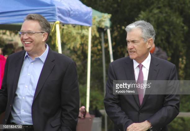 Photo taken Aug. 24 shows U.S. Federal Reserve Chairman Jerome Powell and Federal Reserve Bank of New York President John Williams chatting during an...