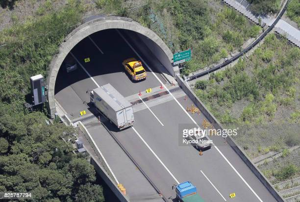 Photo taken Aug 3 from a Kyodo News helicopter shows the entrance to a tunnel at Shin Tomei Expressway in the central Japan city of Shimada Two...