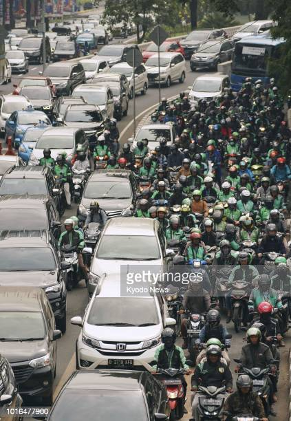 Photo taken Aug 7 shows a street in Jakarta congested with bikes and cars ==Kyodo