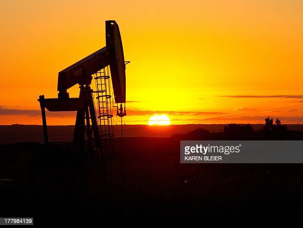 Photo taken August 21 2013 shows an oil well near Tioga North Dakota AFP PHOTO / Karen BLEIER