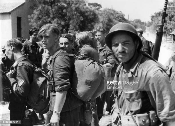 A photo taken August 28 in the southern French port city of Marseille shows German prisonners being watched by Algerian soldiers allies at the...