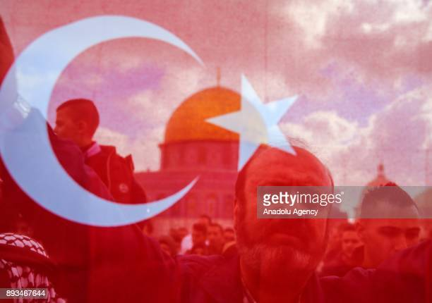 A photo taken behind a Turkish flag shows the protesters during a demonstration against US President Donald Trumps announcement to recognize...
