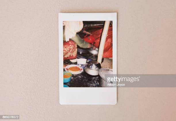 COX'S BAZAR BANGLADESH DECEMBER 03 A photo taken by 16 year old Farmina Begum of her mom cooking breakfast in a refugee camp is seen December 3 2017...