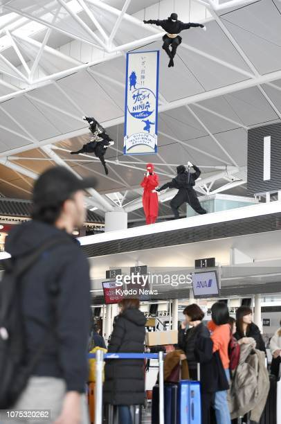 Photo taken Dec. 1 shows ninja mannequins above check-in counters at Chubu airport in Aichi Prefecture, central Japan. The airport is located near...