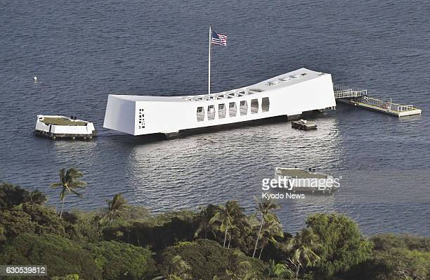 Photo taken Dec 25 shows the USS Arizona Memorial in Pearl Harbor Hawaii Japanese Prime Minister Shinzo Abe is scheduled to make a twoday trip from...