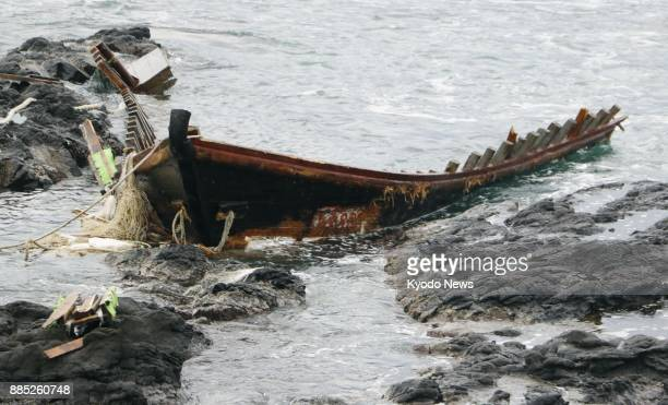 Photo taken Dec 4 shows the remnants of a wooden boat believed to be from North Korea washed ashore in Tsuruoka in Japan's Yamagata Prefecture A...