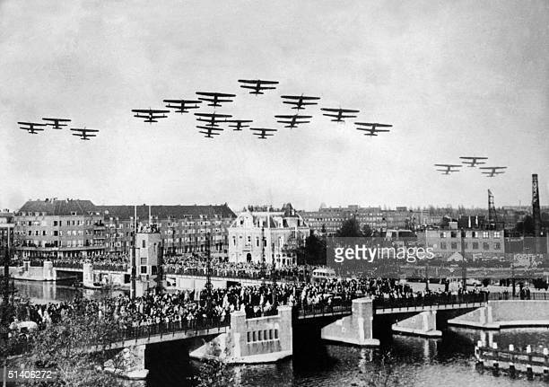 Photo taken during the World War II of planes flying above a Dutch city