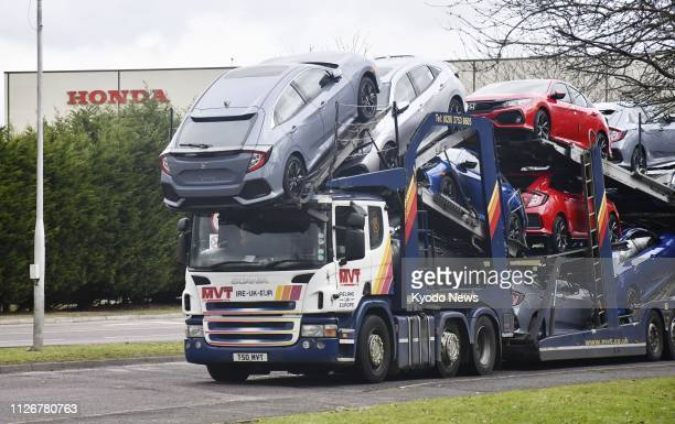 Photo taken Feb 20 shows a truck carrying cars assembled at Honda Motor Co's plant in Swindon Britain The company announced earlier this month that...