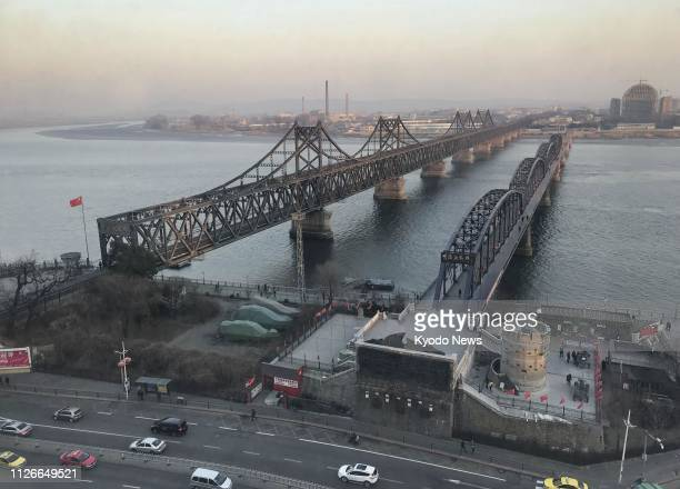 Photo taken Feb. 21 shows the Sino-Korean Friendship Bridge that links China's Dandong and North Korea's Sinuiju. ==Kyodo