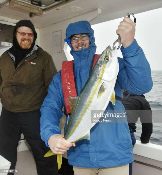 Photo taken Feb 25 shows Devin Mackin a 21yearold Marine participating in a fishing tour organized by former US serviceman Edward Hosack in the Seto...